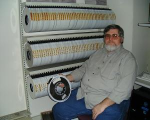 David Wiseman with the 141 magtapes from Henry Spencer's USENET collection. C